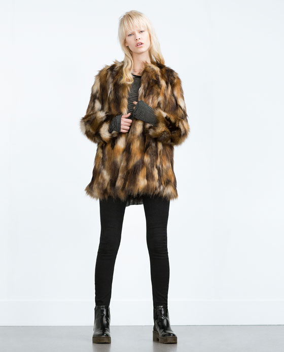 For the look of real fur without the animal cruelty, Zara faux fur coats make a great option. Find them in waist-length fits finished with extravagant layers of long, shaggy fake fur in white, brown, and black.